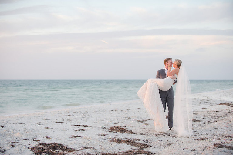 Bride and Groom Oceanfront Clearwater Beach Wedding Portrait in the Sand | Clearwater Beach Wedding Planner Parties a la Carte | Photographer Marc Edwards Photographs