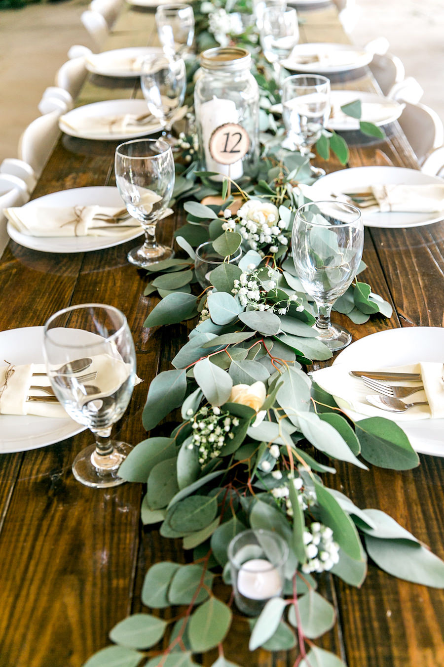 Long Feasting Table with Garland Greenery Centerpieces and Wooden Farm Tables     Rustic, Country Wedding Reception Decor Inspiration