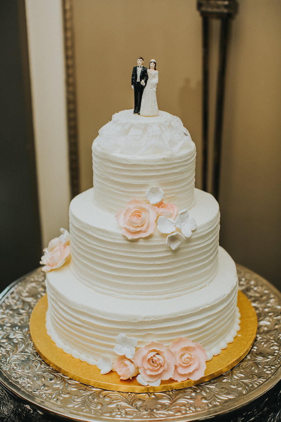 Traditional Buttercream Texture White Wedding Cake with Pink Sugar Roses and Bride and Groom Cake Topper