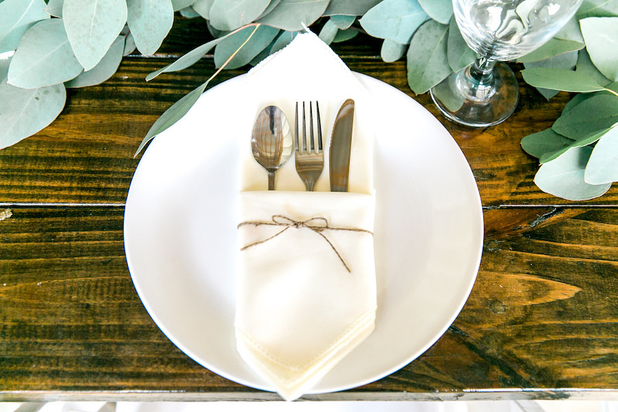 Place Setting with White Napkin in Twine Rope with Garland Greenery Centerpieces and Wooden Farm Tables   Rustic, Country Wedding Reception Decor Inspiration