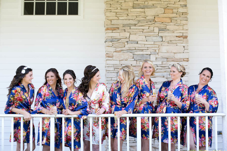 Bride and Bridesmaids Drinking Champagne on Wedding Day in Navy Blue and White Floral Robes | Tampa Bay Wedding Videographer Hatfield Productions