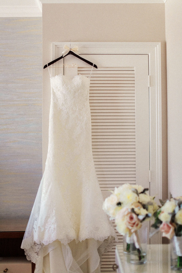 White Sweetheart Strapless Lace Pronovias Wedding Dress with Bridal Bouquet Portrait
