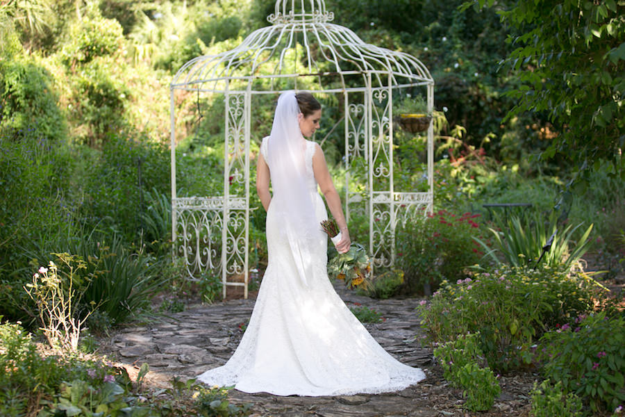Outdoor Tampa Bay Bridal Wedding Portrait in Mikaella Bridal Dress with Veil | Tampa Bay Wedding Photographer Carrie WIldes Photography | Cross Creek Ranch