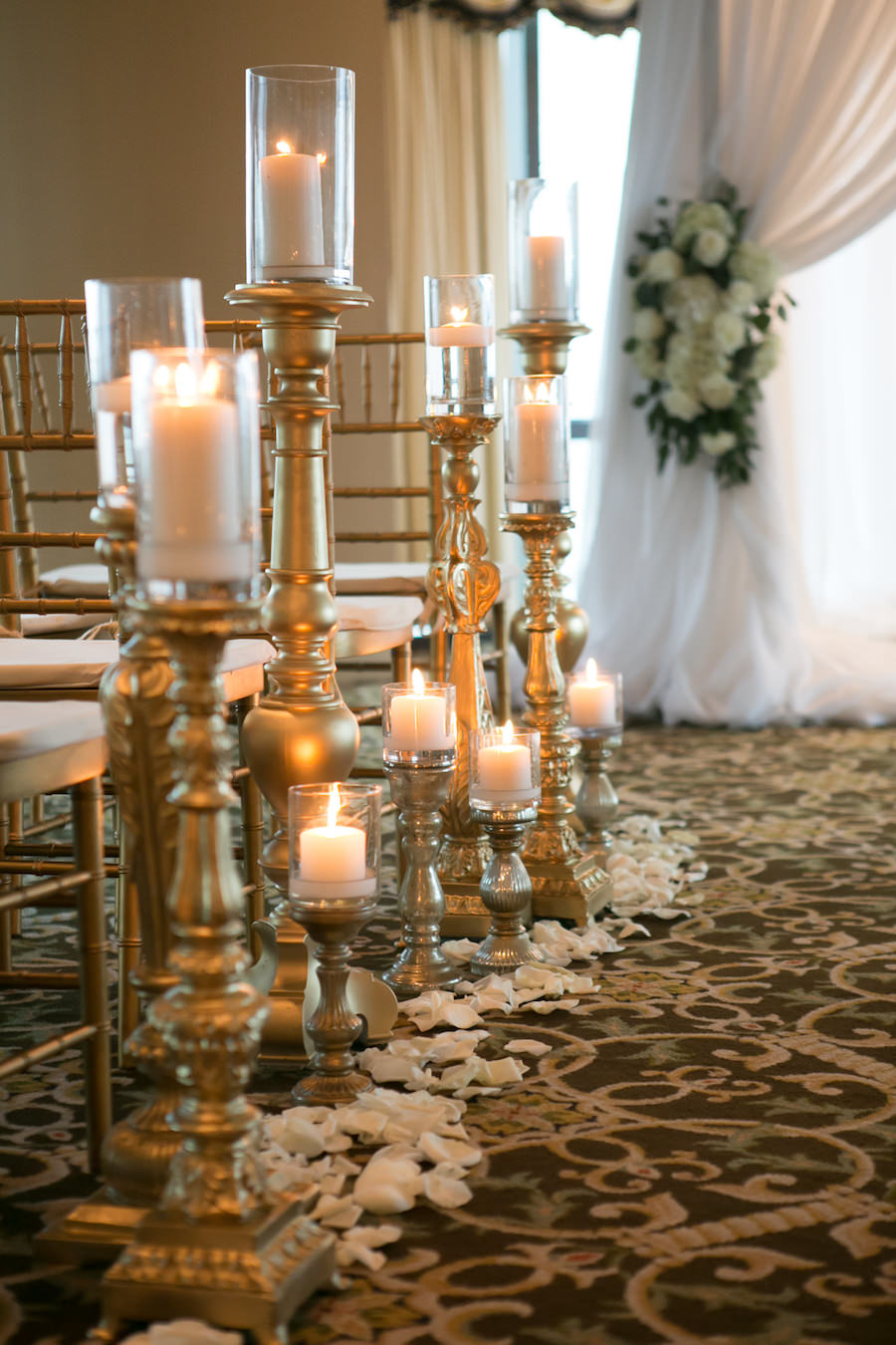 White and Gold Wedding Ceremony Decor and Inspiration with Gold Chiavari Chairs and Candles with White Rose Petals   Modern Elegant Downtown Tampa Wedding Venue The Tampa Club   Tampa Bay Florist Northside Florist   Rentals A Chair Affair