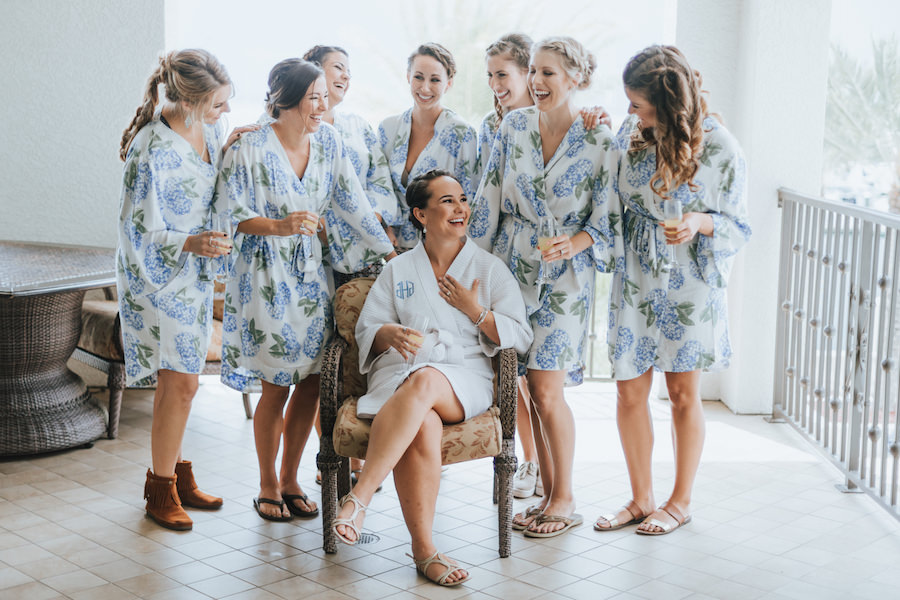 Bridesmaids and Bride Getting Ready Wedding Portrait in Floral Blue and White Robes