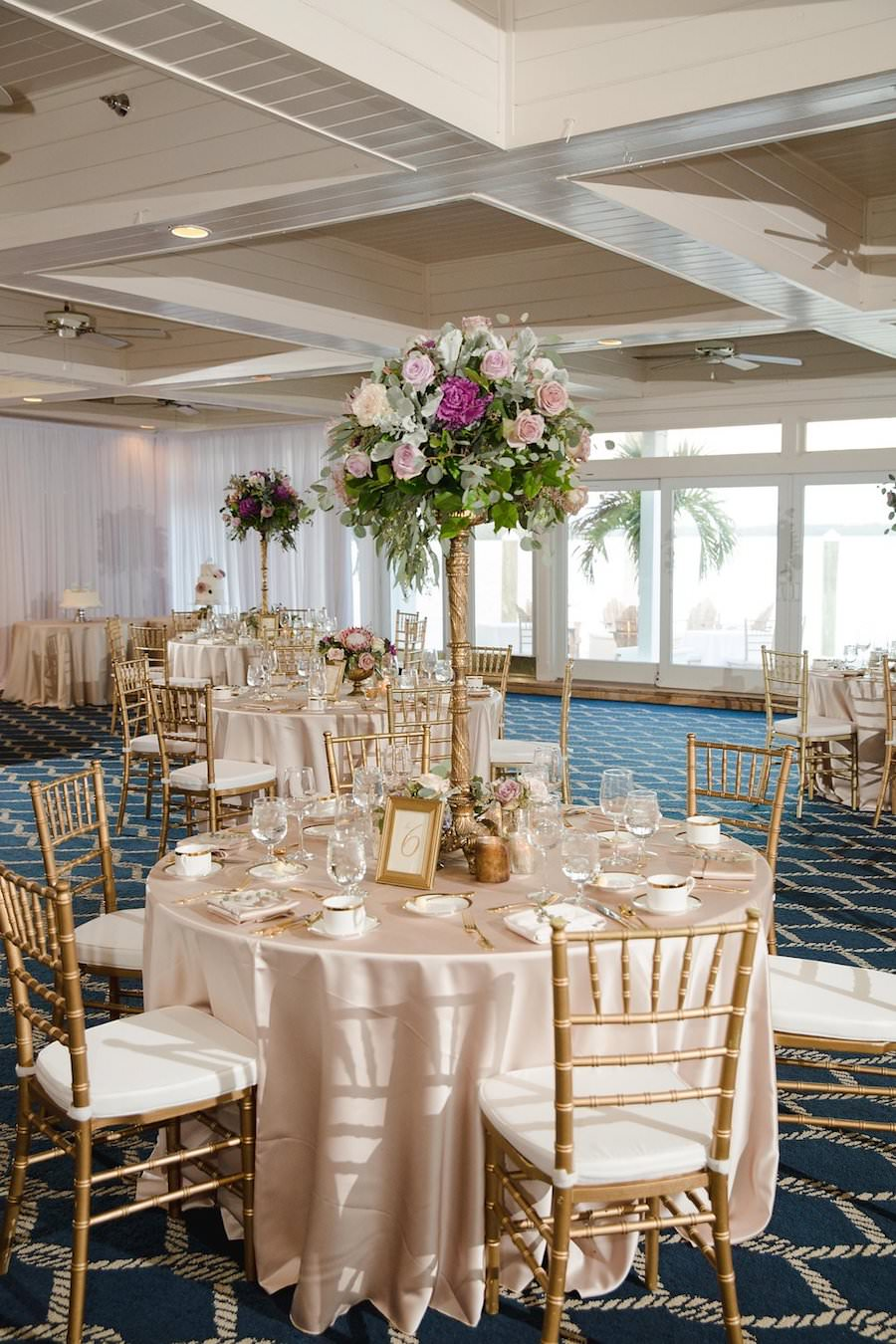 Tall Blush Pink Rose Centerpieces with Greenery, Satin Linens and Gold Chiavari Chairs | Elegant Traditional Gold Wedding Reception Decor | Clearwater Beach Wedding Planner Parties a la Carte