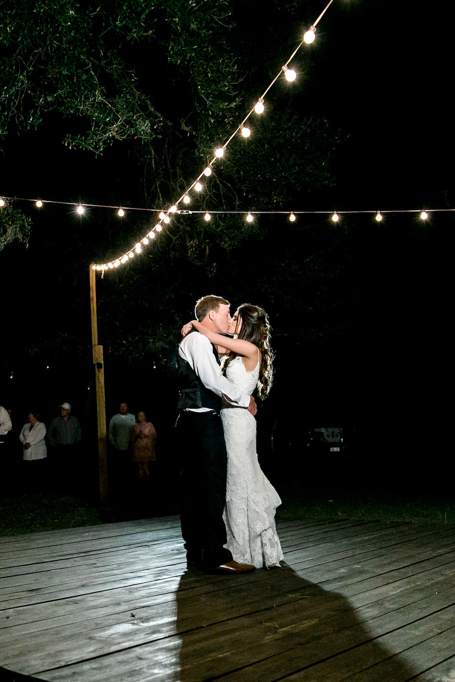 Bride and Groom First Dance at Night with Market Lighting   Outdoor Tampa Bay Wedding Venue