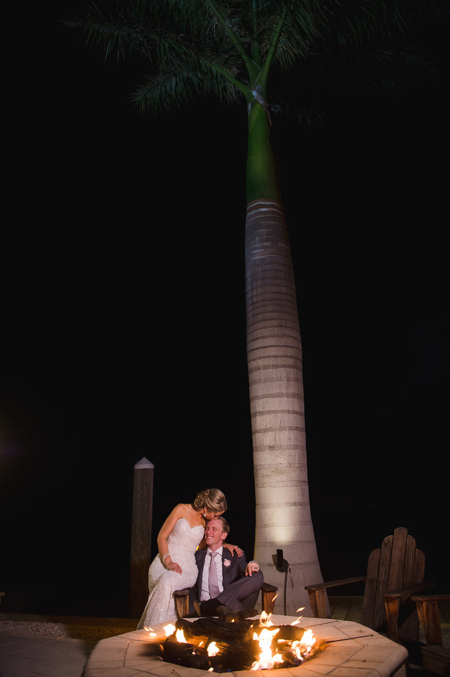Bride and Groom Portrait by Wedding Reception Fire Pit | Clearwater Beach Wedding Planner Parties a la Carte | Photographer Marc Edwards Photographs
