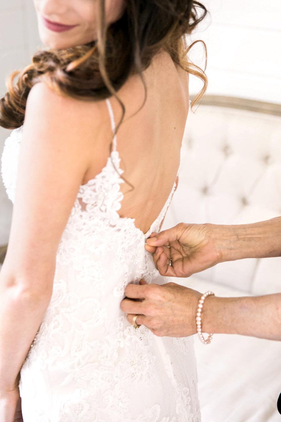 Bride Getting Ready in Lace Open Back Wedding Dress