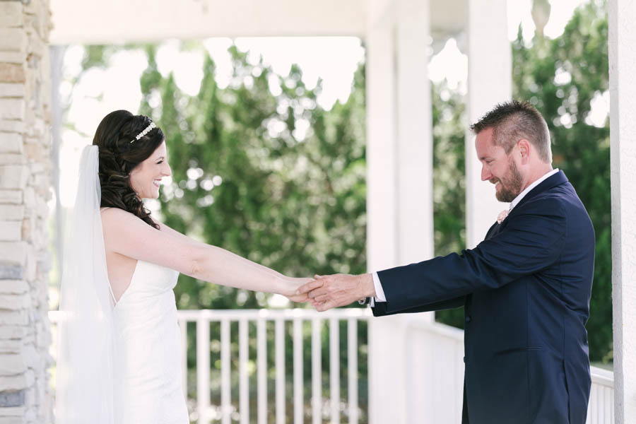 Bride and Groom First Look Wedding Portrait on Front Porch   Tampa Bay Wedding Videographer Hatfield Productions