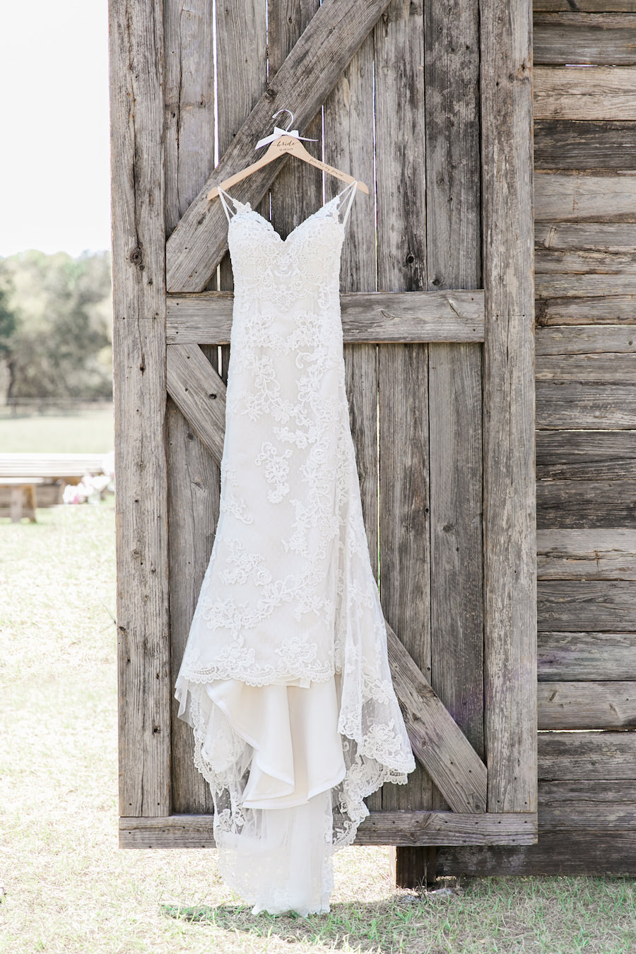 Lace Open Back Wedding Dress with Spaghetti Straps on Barn Door   Rustic, Country Wedding Inspiration