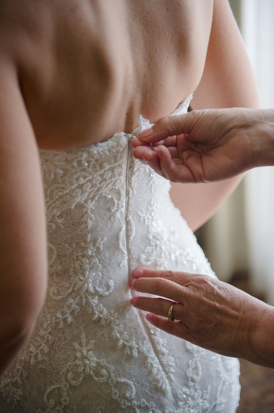 Bride Getting Dressed on Wedding Day in Ines di Santo Strapless Sweetheart Wedding Dress with Lace