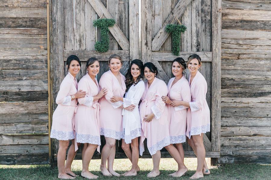 Bridesmaids in Matching Blush Pink Bridal Party Robes