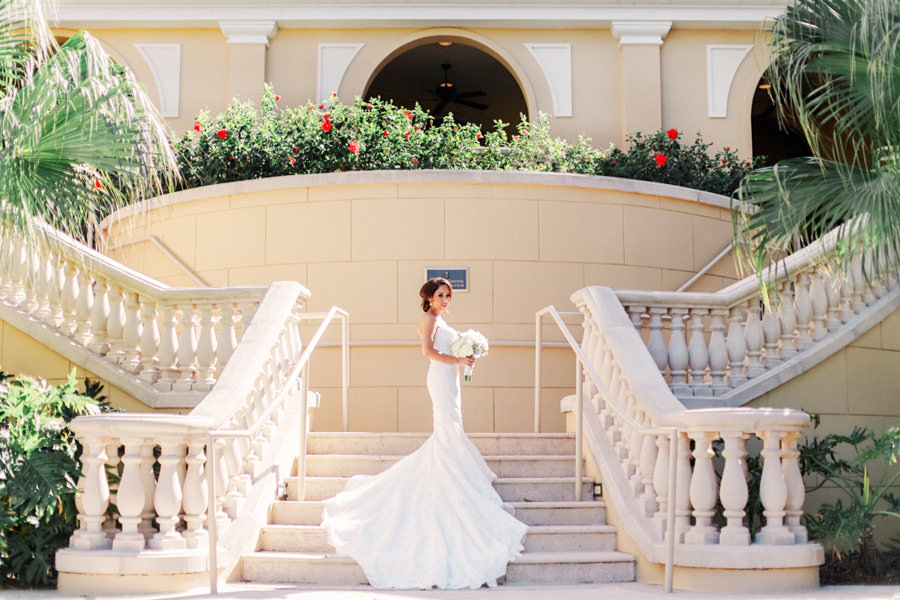 Outdoor Bridal Wedding Portrait in White Sweetheart Strapless Lace Pronovias Wedding Dress with Ivory, White and Greenery Bridal Wedding Bouquet