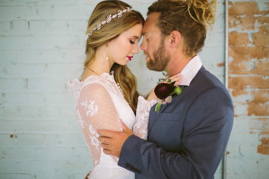 Modern Bohemian Inspired Wedding Styled Shoot Portrait of Bride in Long Sleeve Lace Isabel O'Neil Bridal Collection Wedding Gown and Groom in Grey Suit
