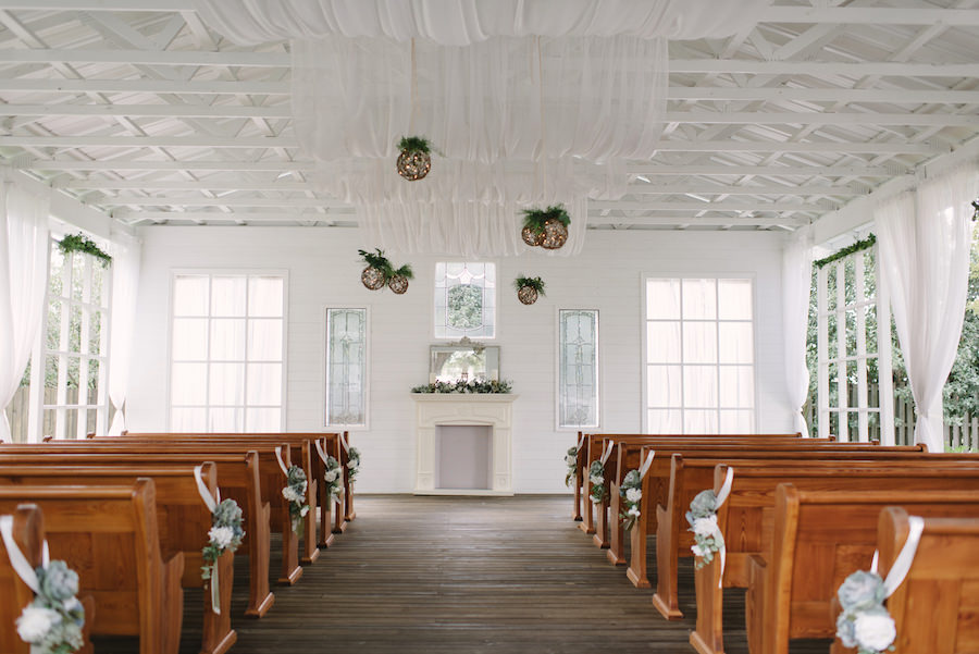 Rustic Wedding Ceremony with Dusty Miller Aisle Decor and All White Altar at Outdoor Tampa Bay Wedding Ceremony Venue Cross Creek Ranch