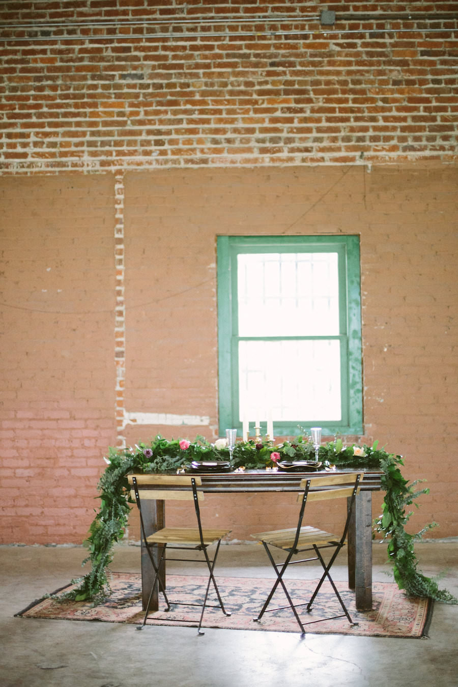 Florida, Modern Bohemian Inspired Styled Shoot | Vintaged Wooden Sweetheart Table with Folding Chairs and Greenery Garland Decor | Tampa Bay Wedding Planner Glitz Events