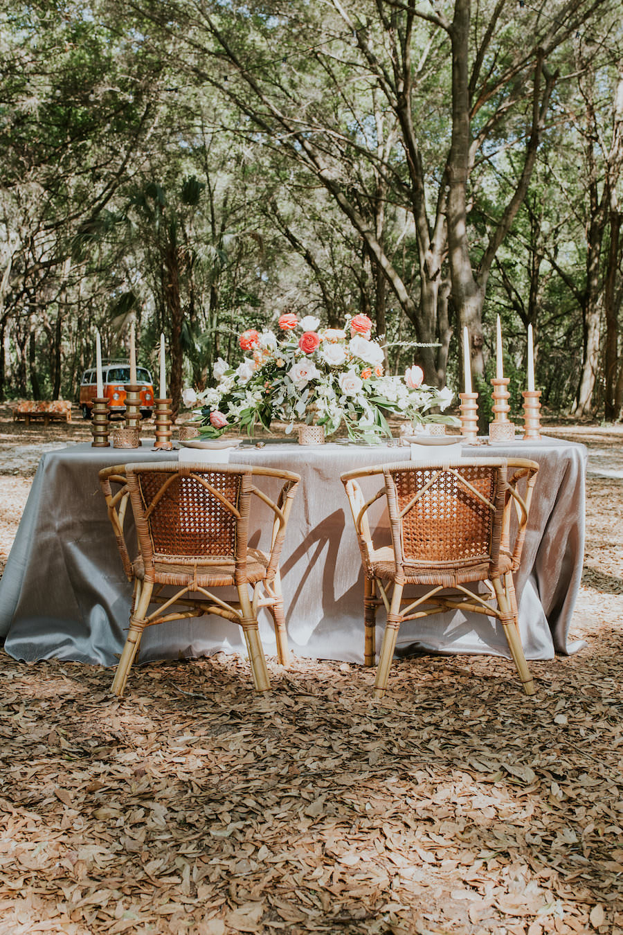 Peach and Blush Pink Wedding Centerpieces with Greenery, Candles, Wicker Chairs and Shimmery Neutral Linens   Retro Vintage Boho Wedding Inspiration   Tampa Wedding Florist Northside Florist   Planner Glitz Events   Outdoor Venue Casa Lantana   Over the Top Linen Rentals
