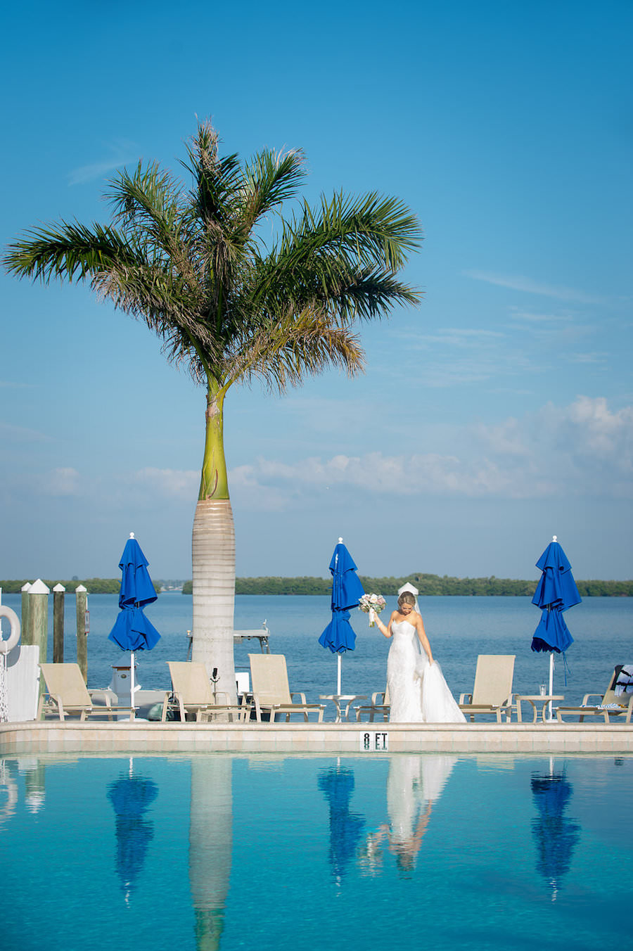Waterfront Poolside Bride Wedding Day Portrait in Ines di Santo Strapless Sweetheart Wedding Dress with Lace with White and Blush Pink Dusty Rose Wedding Bouquet with Succulents and Greenery | Clearwater Beach Wedding Photographer Marc Edwards Photographs