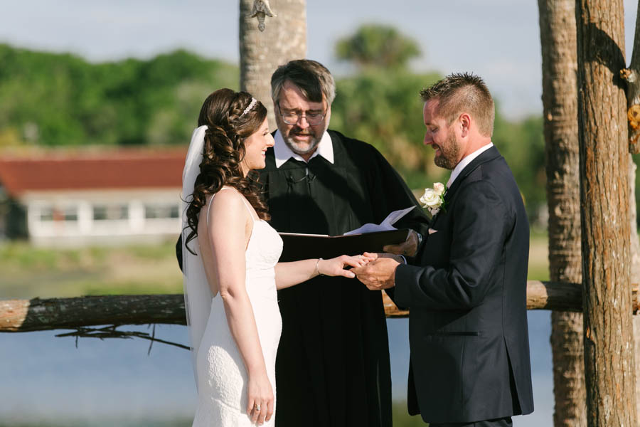 Bride and Groom Exchanging Rings Wedding Ceremony Portrait   Tampa Bay Wedding Videographer Hatfield Productions