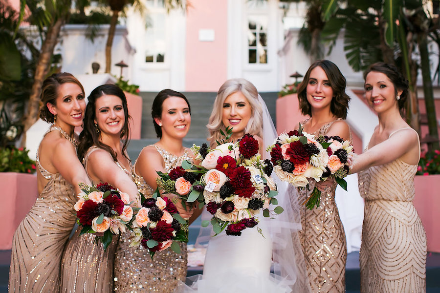 Florida Bridal Wedding Party Portrait at Don CeSar Hotel in St. Pete Beach   Ivory Strapless Drop Waist Pronovias Wedding Dress and Champagne, Gold Bridesmaids Dresses with Burgundy and Pink Floral Bouquets   Pronovias Wedding Dress   Tampa Wedding Photographer Limelight Photography