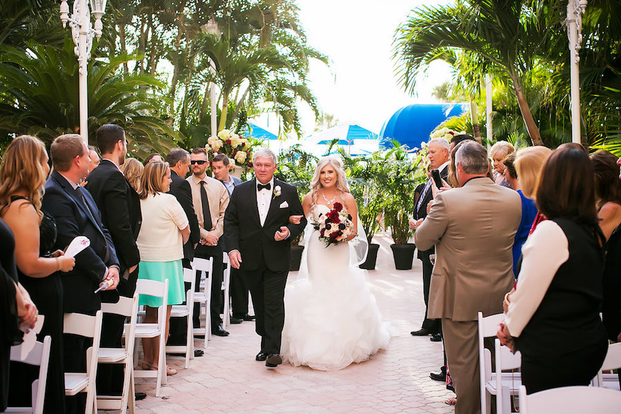 Outdoor Florida Wedding Ceremony Portrait of Bride and Father Walking Down the Aisle   St Pete Beach Wedding Venue The Don CeSar Hotel   Limelight Photography