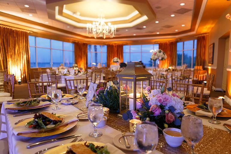 Gold Wedding Reception Decor with Long Feasting Table, Sequined Linen Runner and Lanterns with Candles | Elegant, Romantic Reception Decor Ideas | Waterfront Nautical St. Petersburg Wedding Venue Isla Del Sol Yacht & Country Club | Photographer Brian C. Idocks Photographics
