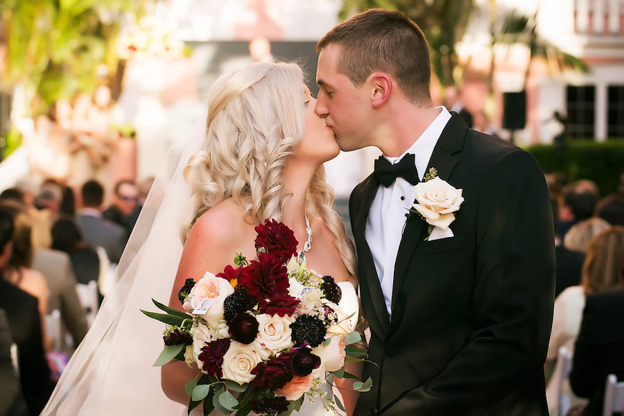 Bride and Groom Wedding Ceremony First Kiss Portrait with Burgundy and Pink Bridal Bouquet   St Pete Wedding Photographer Limelight Photography