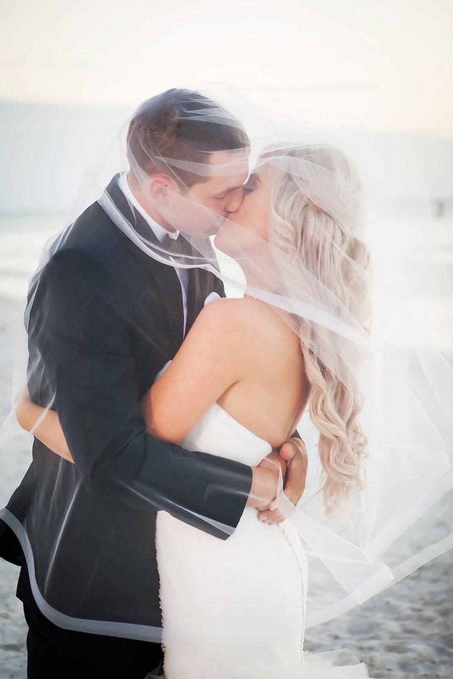 St Pete Beach Bride and Groom Wedding Kissing Portrait Under Veil   Don CeSar Wedding   St Pete Wedding Photographer Limelight Photography