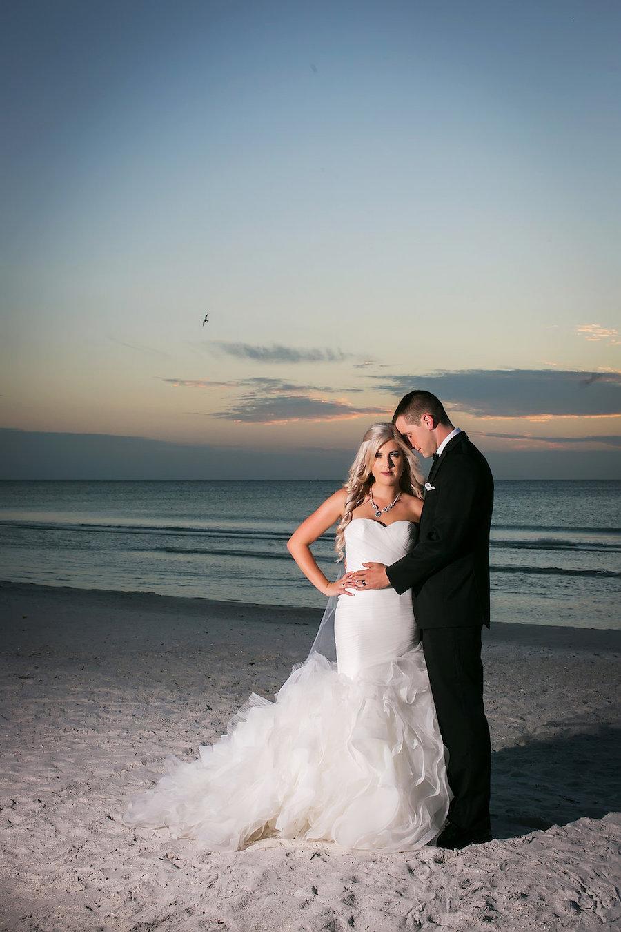 St Pete Beach Bride and Groom Wedding Portrait   Pronovias Bridal Wedding Dress   Don CeSar Wedding   St Pete Wedding Photographer Limelight Photography