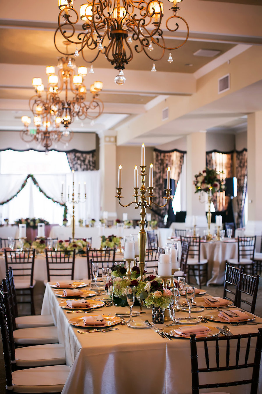 Don CeSar Hotel, St Pete Florida Wedding Reception with Feasting Tables and Brown Chiavari Chairs with Gold Candelabras   Limelight Photography