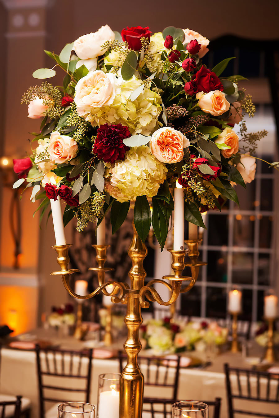 Burgundy and Gold Don CeSar Hotel, St Pete Florida Wedding Reception with Brown Chiavari Chairs with Gold Candelabras and Tall Floral Centerpieces with Candlesticks   Limelight Photography