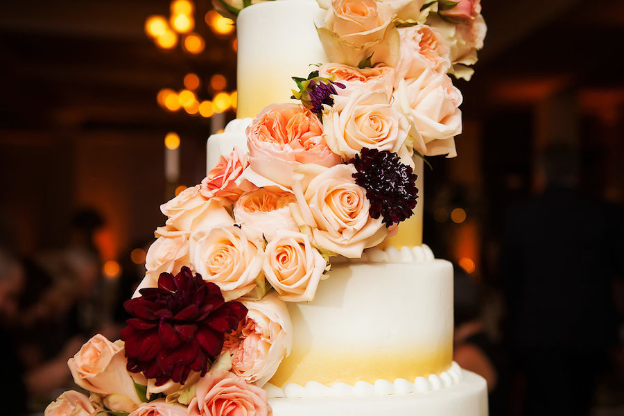 Four Tiered Round Ombre Wedding Cake with Fresh Pink and Red Rose Garland   Limelight Photography