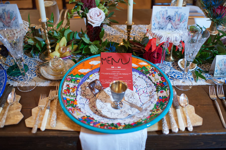 Florida Bohemian Modern Museum Wedding Reception Vintage Farm Tables with Wooden Chiavari Chairs and Ikat Table Runner with Candlestick Decor, Vintage Stemware and Cutlery and Graffiti Art Menu Card | Tampa Bay Vintage Rental Company Reserve Vintage Rentals