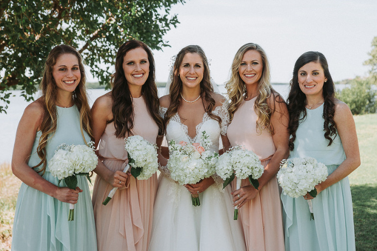 Pastel Bridesmaids Dresses with Bride in White Wedding Dress with Lace Low Cut Wedding Dress with White Floral Bouquets | St. Pete Wedding Photographer Grind and Press Photography