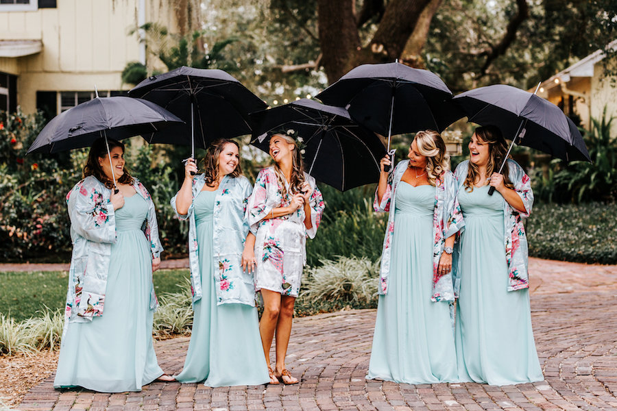 Bride and Bridesmaid Fun Getting Ready Wedding Portrait with Umbrellas and Silk Robes   Light Blue David's Bridal Bridesmaids Dresses
