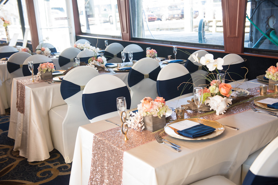 Nautical Inspired Wedding Reception With White Chair Covers And Navy