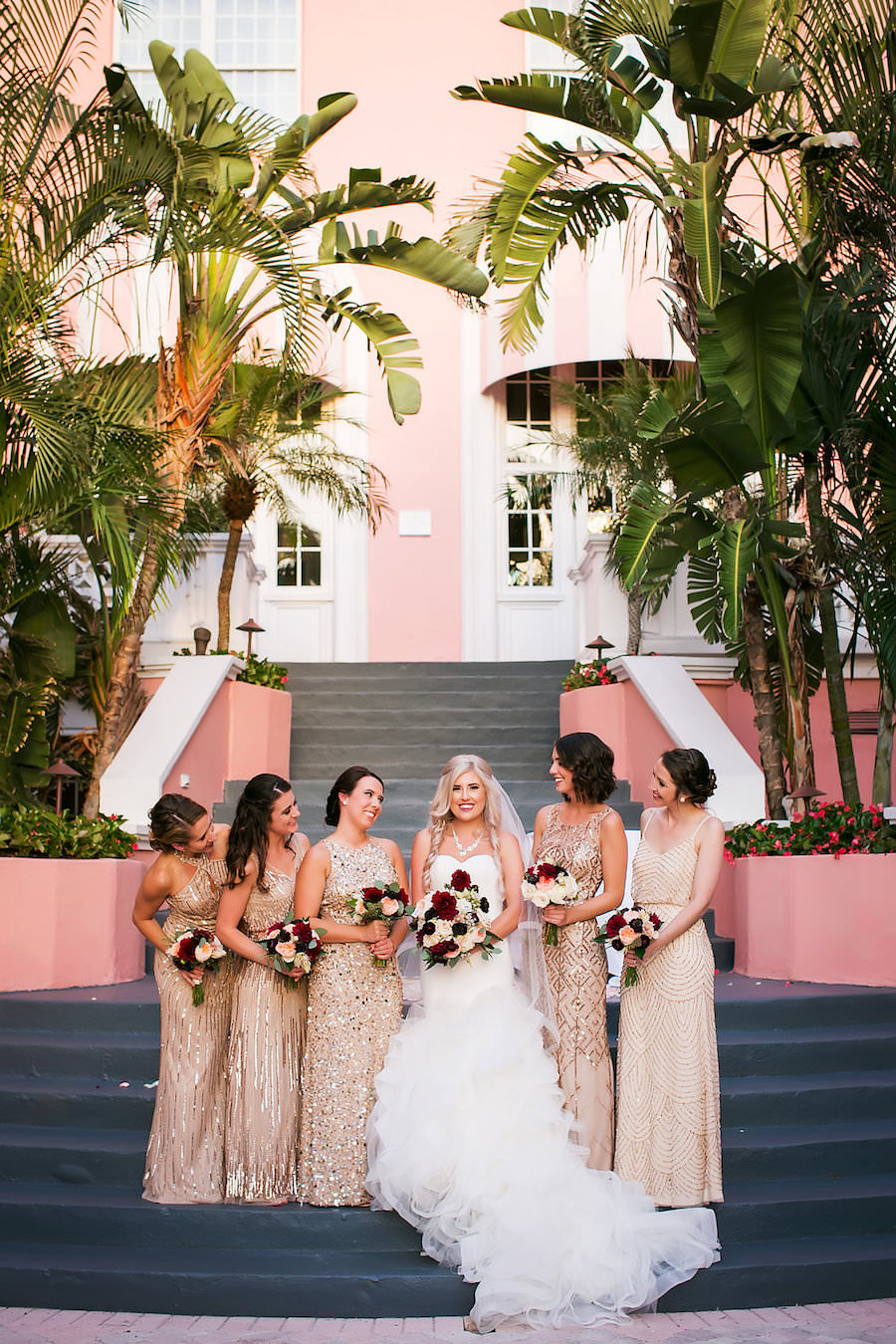 Florida Bridal Wedding Party Portrait at Don CeSar Hotel in St. Pete Beach   Ivory Strapless Drop Waist Pronovias Wedding Dress and Champagne, Gold Bridesmaids Dresses   Pronovias Wedding Dress   Tampa Wedding Photographer Limelight Photography