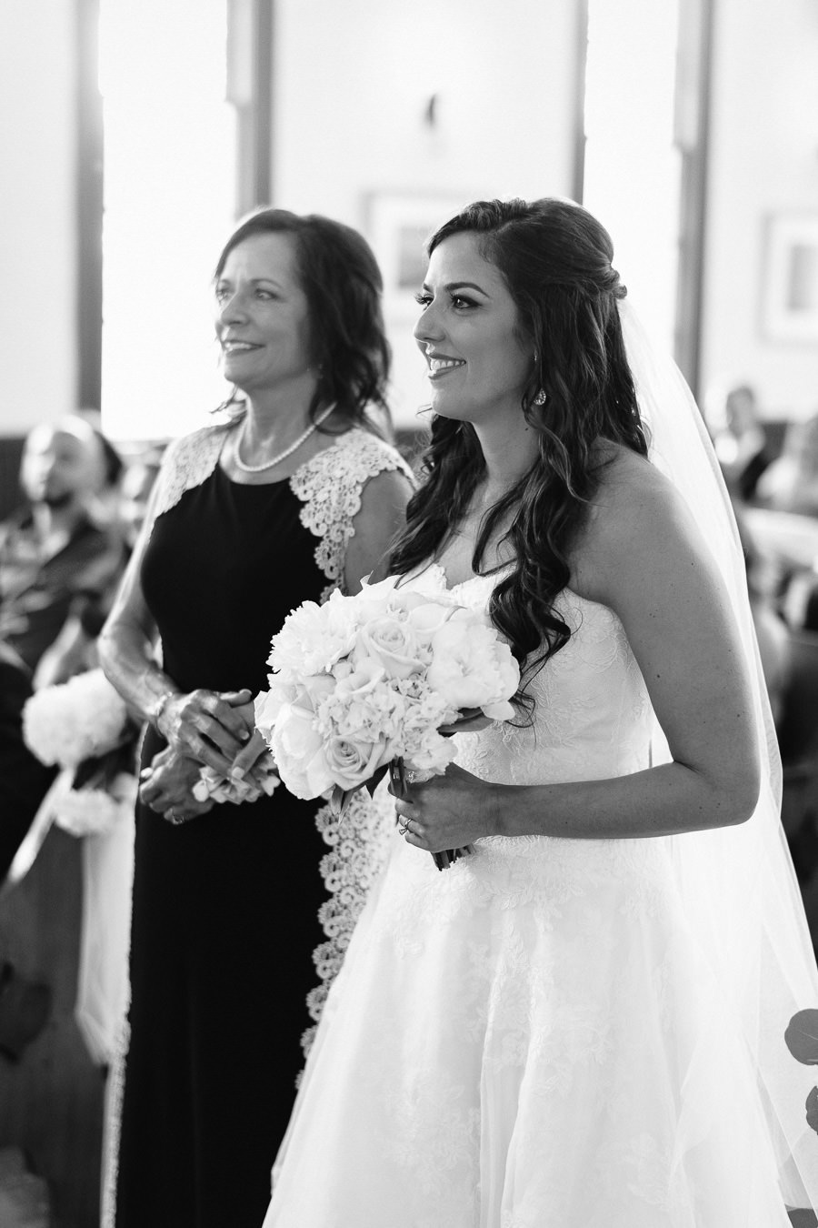 Bride and Mother Walking Down Aisle with White Rose Wedding Bouquet