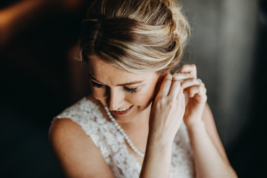 Bride Getting Ready Portrait on Wedding Day Putting Earrings   Tampa Bay Wedding Photographer Rad Red Creative