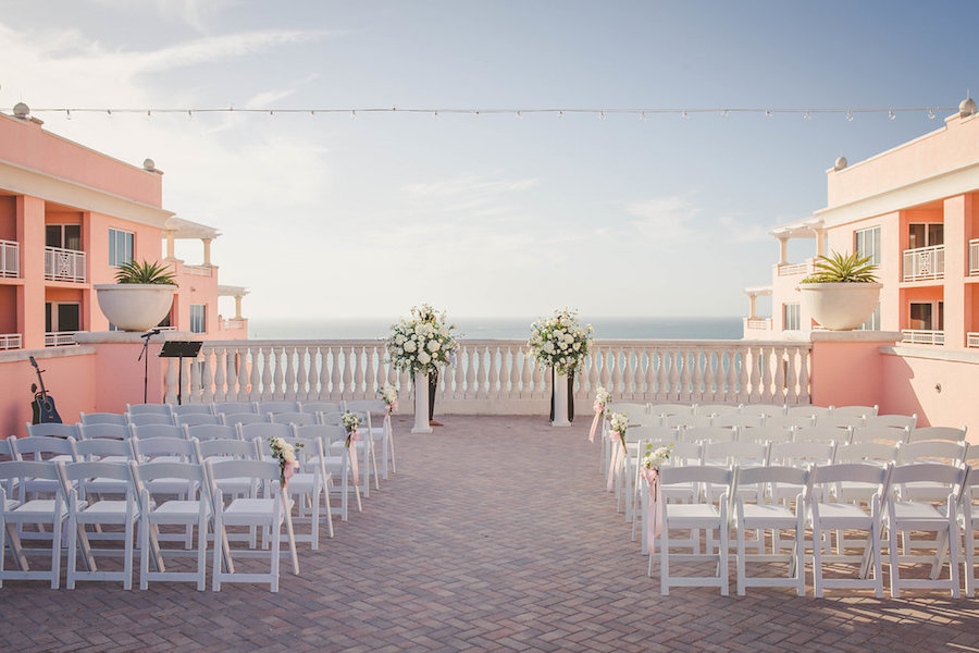 Rooftop Outdoor Hotel Wedding Ceremony Venue Hyatt Regency Clearwater Beach with White Folding Chairs Tall White Bouquets and Blush Ribbon