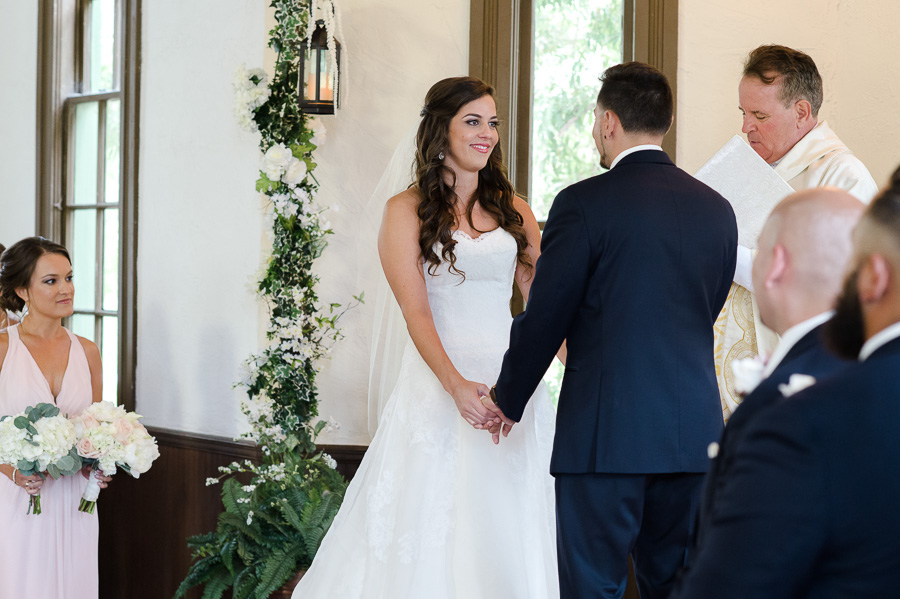 Traditional Wedding Ceremony Portrait with Watters Wedding Dress with Long Train, White Climbing Greenery, Ferns in Copper Basins, and Blush Bridesmaids Dress | | Tampa Bay Wedding Venue Church Andrews Memorial Chapel Dunedin Florida