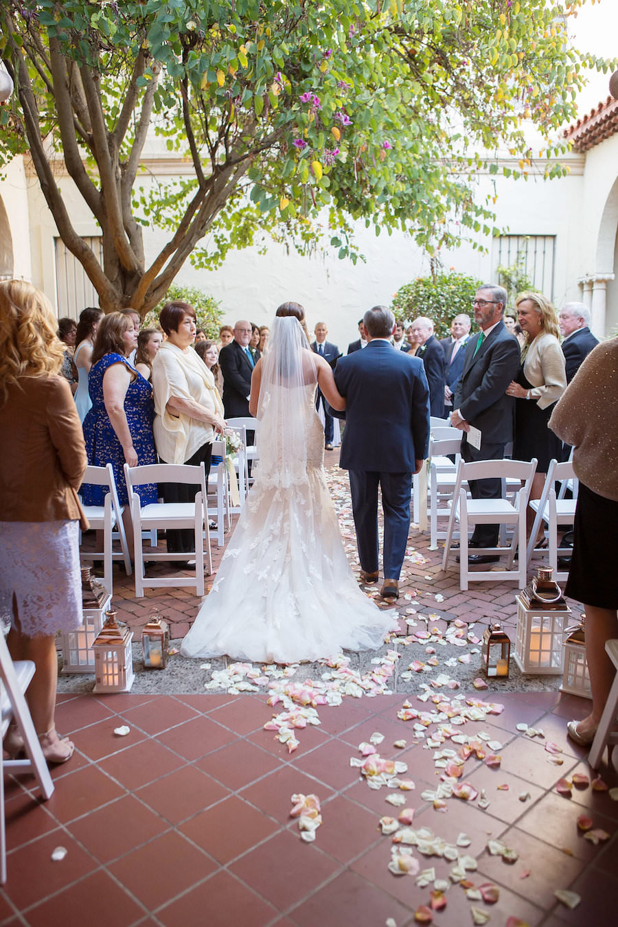 Bride and Father Walking Down Rose Petal Strewn Aisle with White and Gold Candle Holders at Modern Elegant Blush Wedding | St. Petersburg Wedding Photographer Kristen Marie Photography | Wedding Venue Museum of Fine Arts St Pete