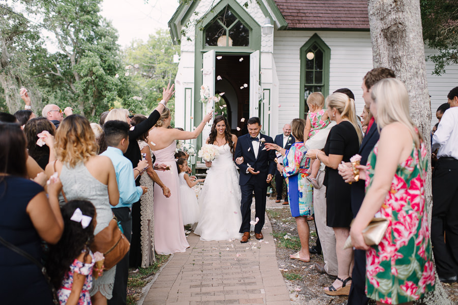 Wedding Ceremony Exit Portrait with Flower Petal Toss at Andrews Memorial Chapel with White Rose Petals | Tampa Bay Wedding