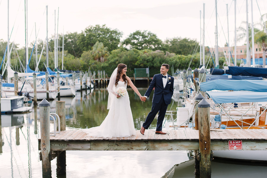 Outdoor Waterfront Wedding Bride and Groom Portrait with Watters Sweetheart Dress, Blush Rose Bouquet with Greenery, and Navy Suit at Tampa Bay Wedding Venue Safety Harbor Resort and Spa