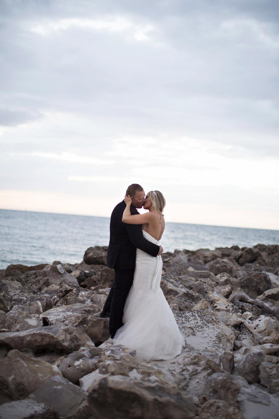 Bridal and Groom Outdoor Wedding Portrait on Rocks | Clearwater Beach Wedding Photographer Djamel Photography