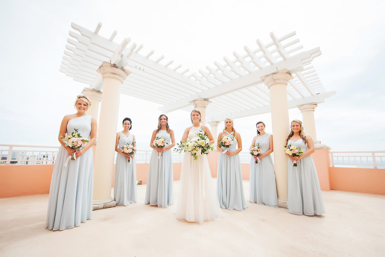 Outdoor Bridal Party Portrait with Light Blue Mismatched Azazie Bridesmaids Dresses and Watters Wedding Dress and White, Pink, Peach, and Yellow Bouquets with Greenery | Hotel Wedding Venue Hyatt Regency Clearwater Resort | Tampa Bay Photographer Limelight Photography