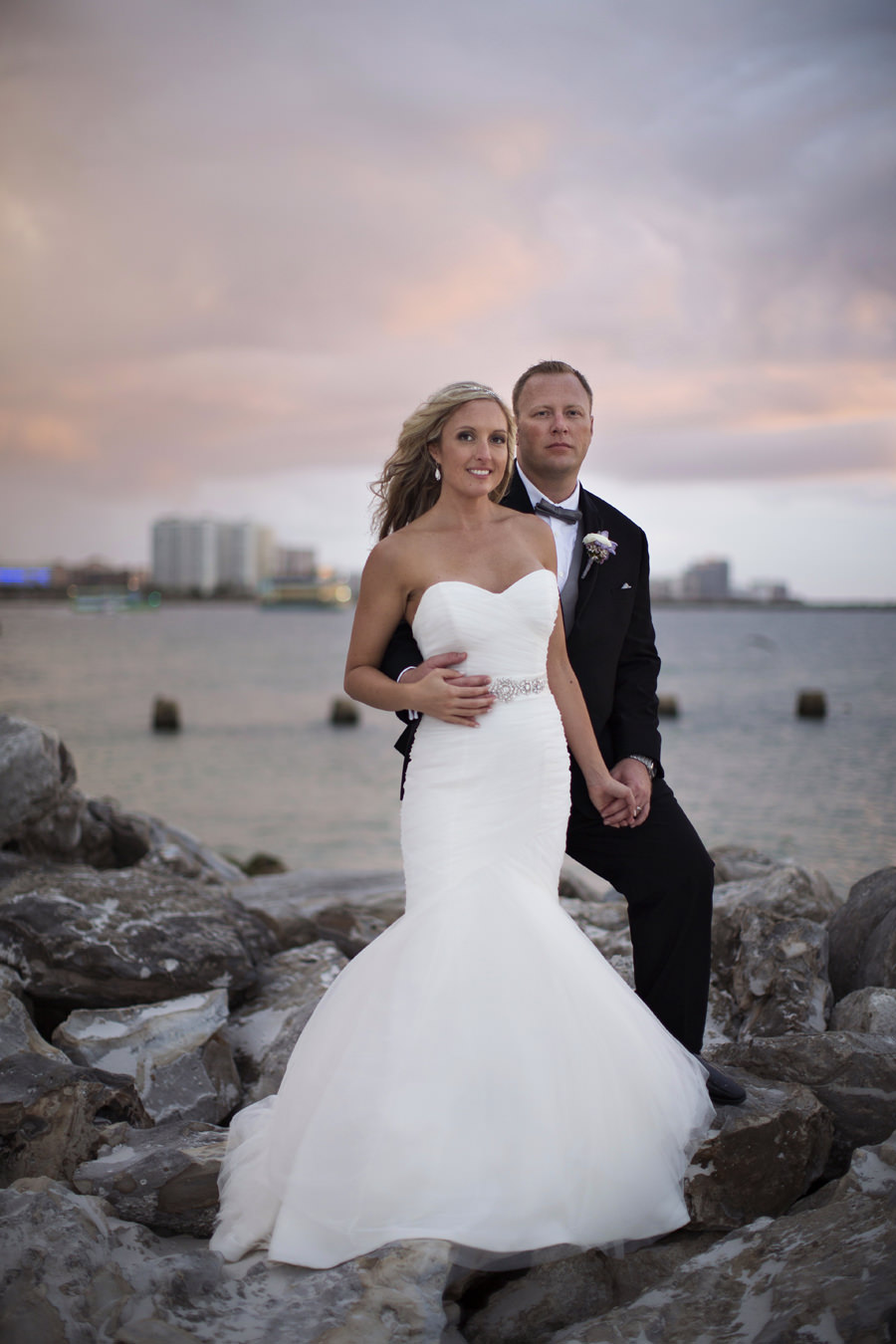Bridal and Groom Outdoor Sunset Wedding Portrait on Rocks | Clearwater Beach Wedding Photographer Djamel Photography