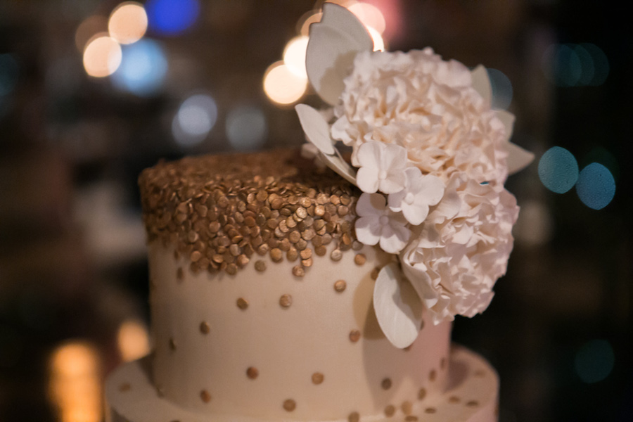 Detail Photo of White Floral Hydrangea Cake Topper on White and Gold Wedding Cake   Tampa Bay Cake Baker Hands on Sweets