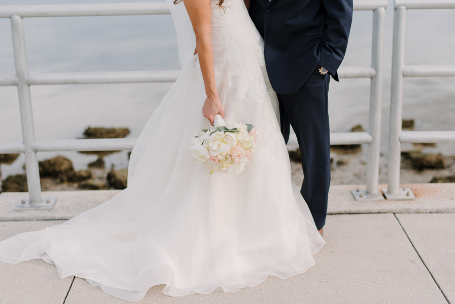 Outdoor Waterfront Wedding Couple Detail Photo Blush Rose Bouquet with Greenery, and Navy Suit at Tampa Bay Wedding Venue Safety Harbor Resort and Spa